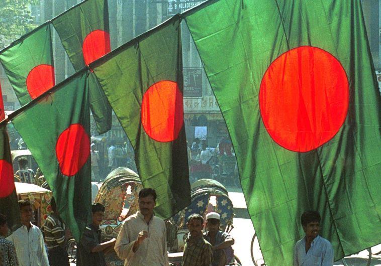Vendors sell Bangladesh national flags in Dhaka
