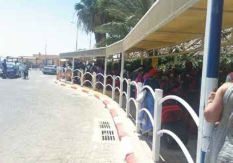 TOURISTS WAIT to enter Sinai at the Eilat-Taba border crossing