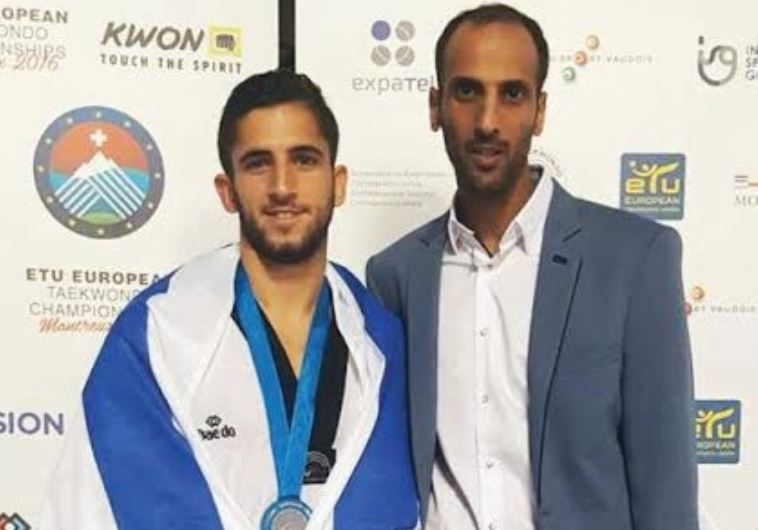 Israeli medalist Ron Atias (left)