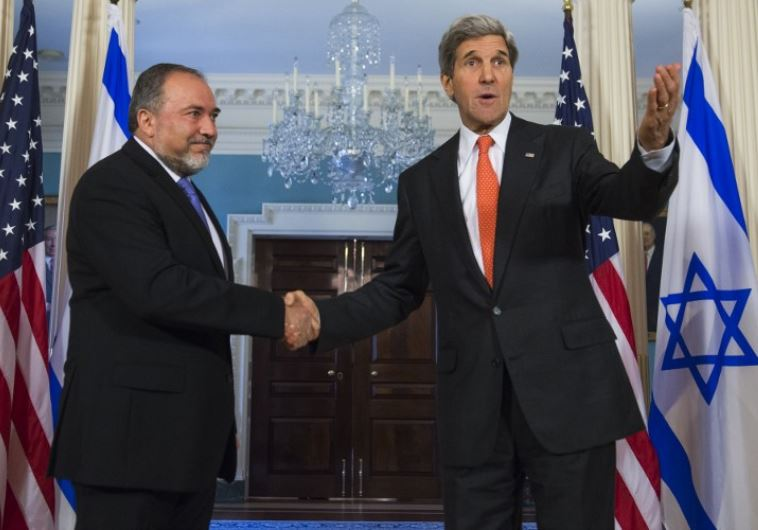 US Secretary of State John Kerry (R) and then-foreign minister Avigdor Liberman shake hands