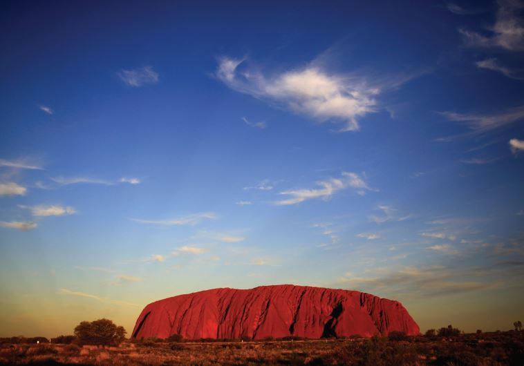 ULURU IS LIT by the setting sun in the Northern Territory in central Australia