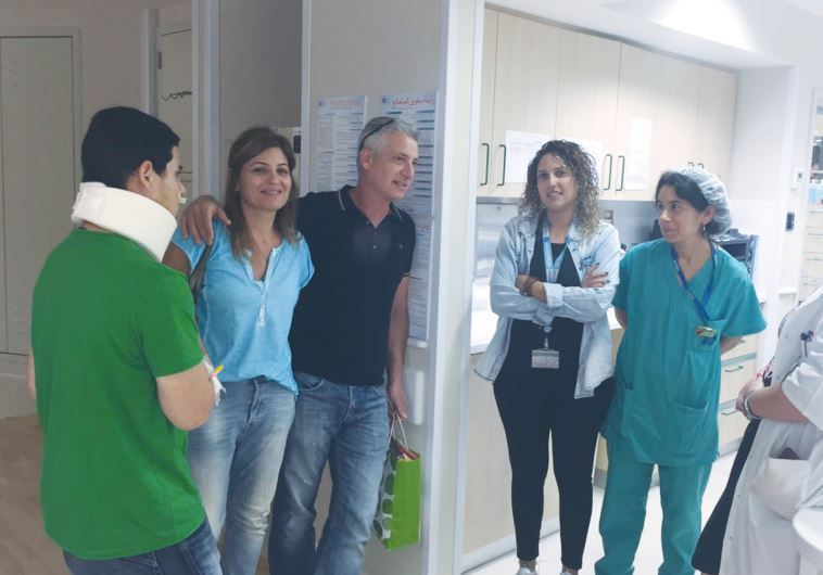 SHAHAR RODITI (left) prepares to leave Hadassah University Medical Center