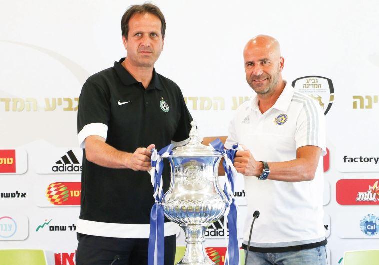 Maccabi Tel Aviv coach Peter Bosz (right), and Maccabi Haifa coach Roni Levy