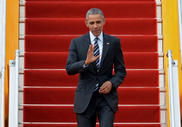US President Barack Obama waves.