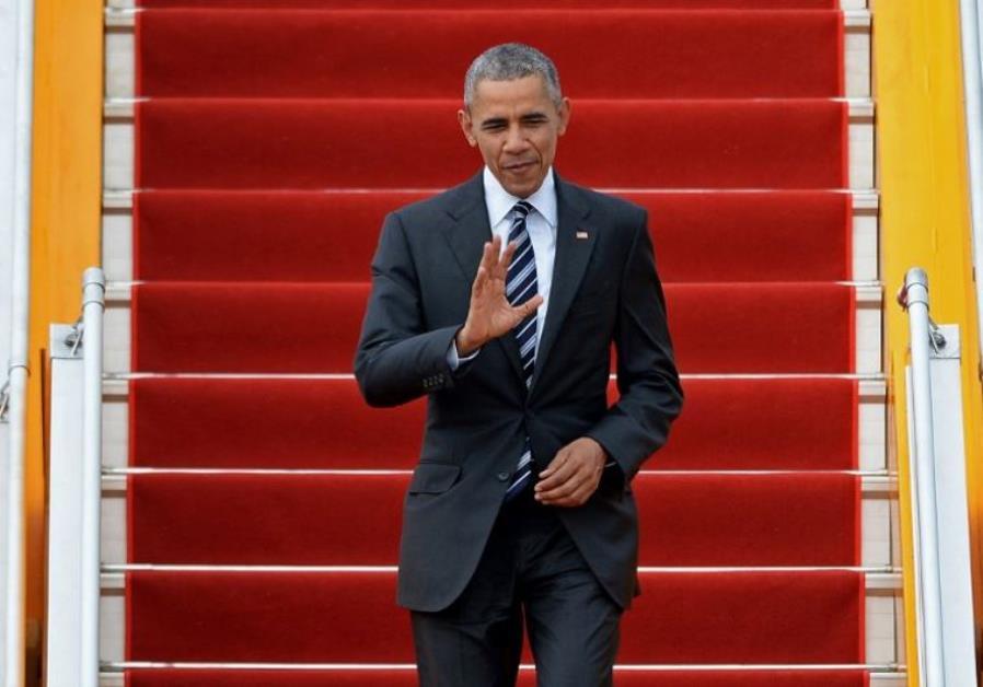 US President Barack Obama waves.