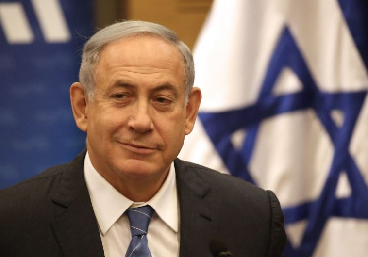 Prime Minister Benjamin Netanyahu talks during his Likud party meeting at the Knesset in Jerusalem