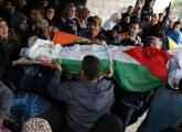 Palestinian mourners carry the bodies of Maram Abu Ismail, 23, and her brother Ibrahim Taha, 16