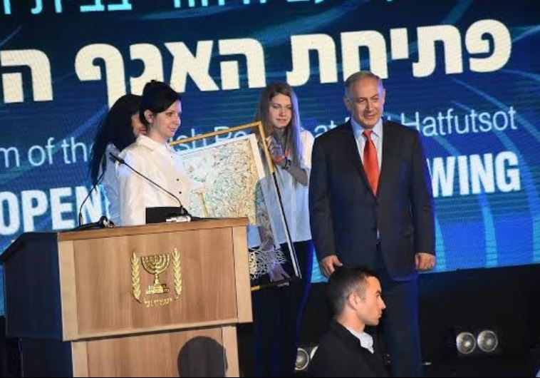 Irina Nevzlin, chair of Beit Hatfutsot board of directors, presents family tree to Netanyahu