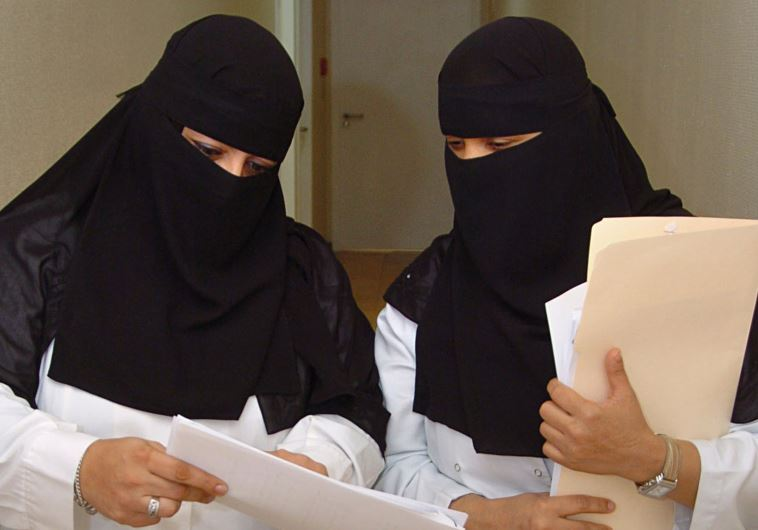 Saudi veiled women doctors work at a hospital in Riyadh
