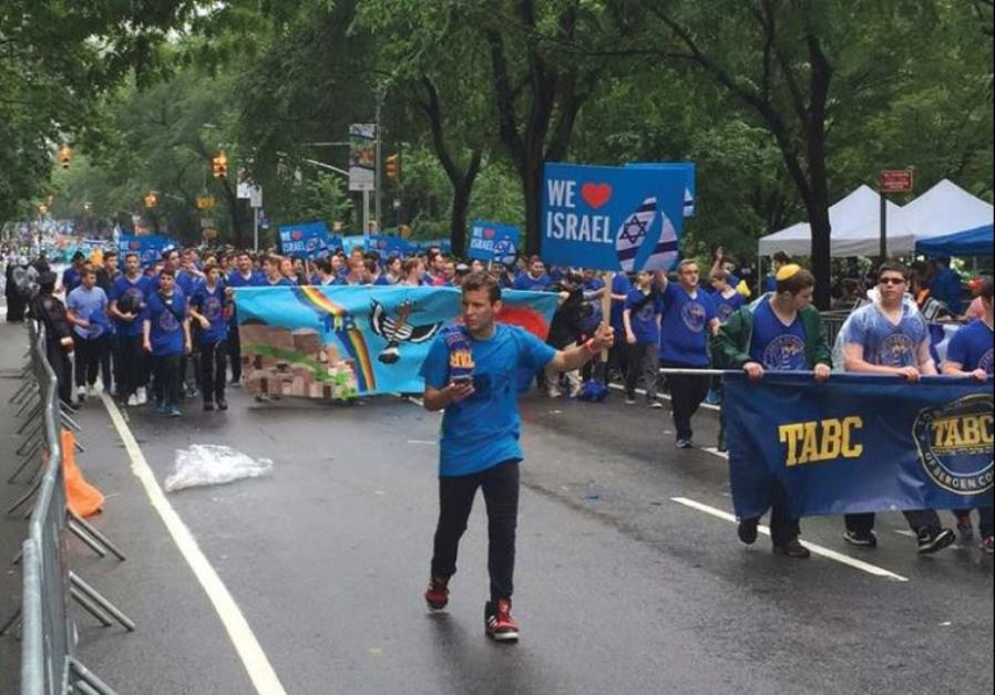 CELEBRANTS MARCH in the Celebrate Israel Parade on Fifth Avenue in Manhattan yesterday, alongside Ce