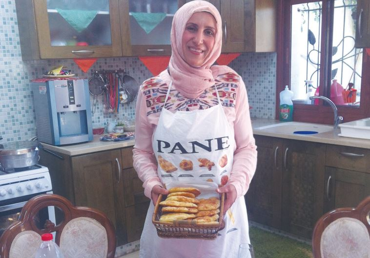 MANAL KARAMAL JEBEREEL, a private caterer, makes iftar meals for families in her home in Umm al-Fahm