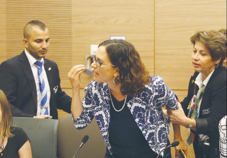 USHERS REMOVE Kulanu MK Rachel Azaria from yesterday's hearing of the Knesset Interior Committee