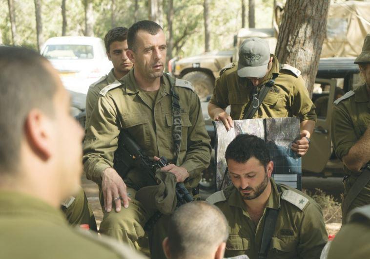 LT.-COL. KAMEEL TAFISH, deputy commander of Brigade 300, briefs commanders and soldiers.