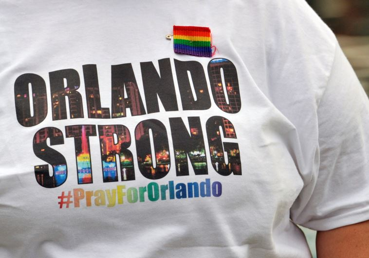 "A resident wears an ""Orlando Strong"" T-shirt during a vigil at Lake Eola Park in Orlando."