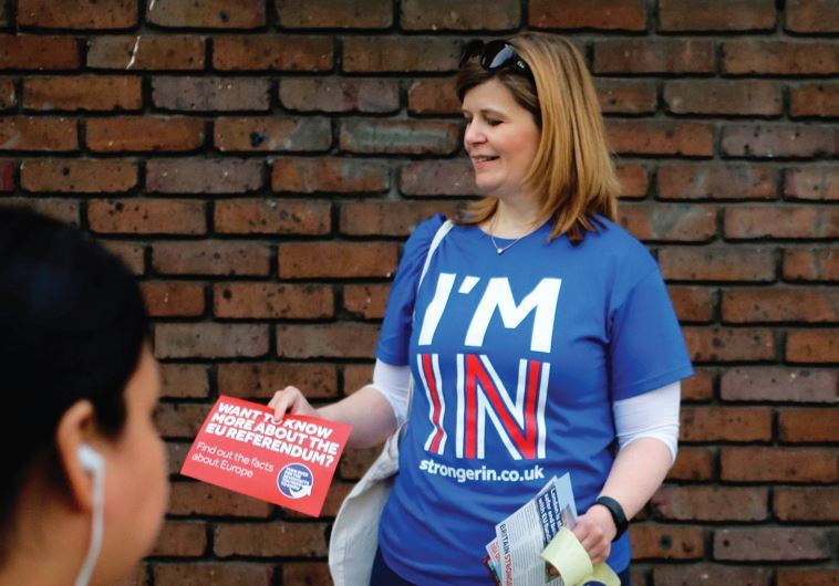 A WOMAN hands out leaflets last month, campaigning to stay in Europe for the Brexit vote, in London.