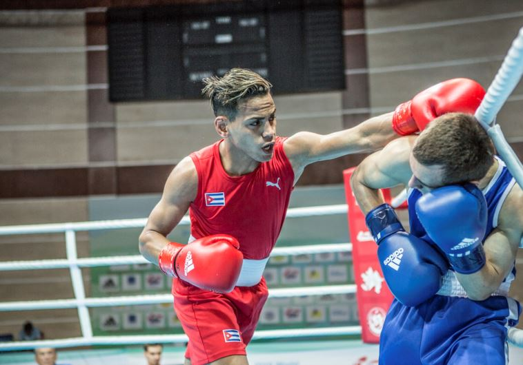 Refusing to compete against Israeli rival, Syrian boxer ...