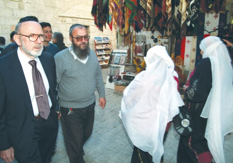 IRVING MOSKOWITZ (left) walks along the Via Dolorosa in Jerusalem's Old City in 1999. Moskowitz, who