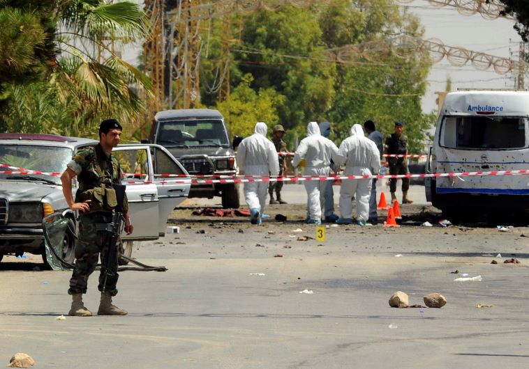 Lebanese army soldiers and forensic inspectors in Qaa