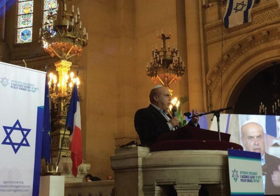 JAFI head Natan Sharansky wishes success yesterday in Paris to French Jews about to make aliya.