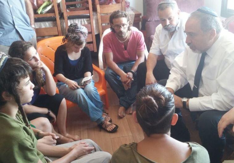 Defense Minister Avigdor Liberman meets with the Mark family children