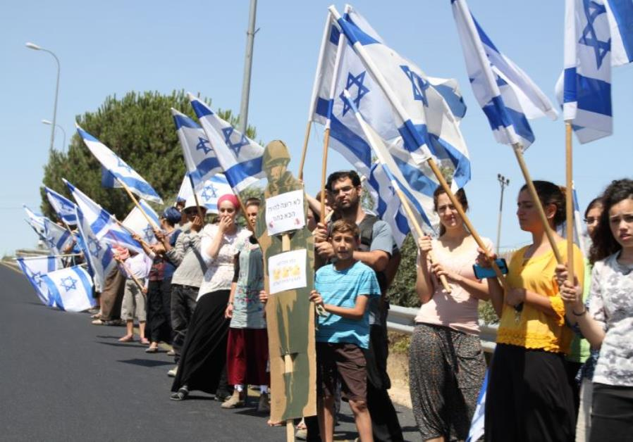 Israelis Settlers protest dangerous West Bank Roadsalong Route 60 on day of Mark funeral.