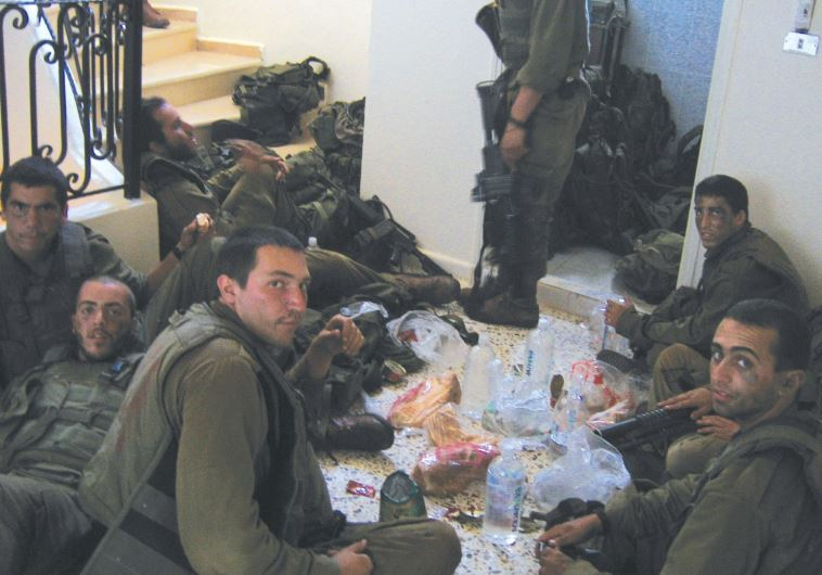 BENYAMIN BEN-ARI (third from left, foreground) and his buddies eat lunch in south Lebanon 10 years a
