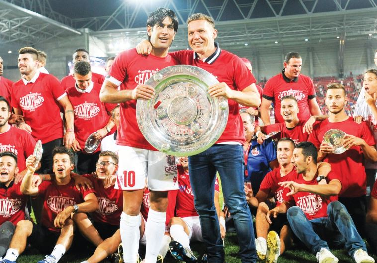 After winning a historic championship last season, Hapoel Beersheba, led by coach Barak Bachar (hold
