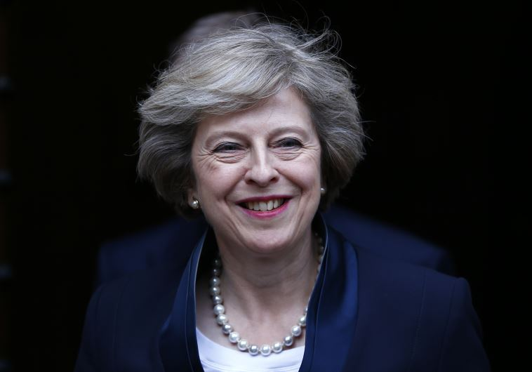 Theresa May emerges to speak to reporters after being confirmed as the leader of the Conservative Pa