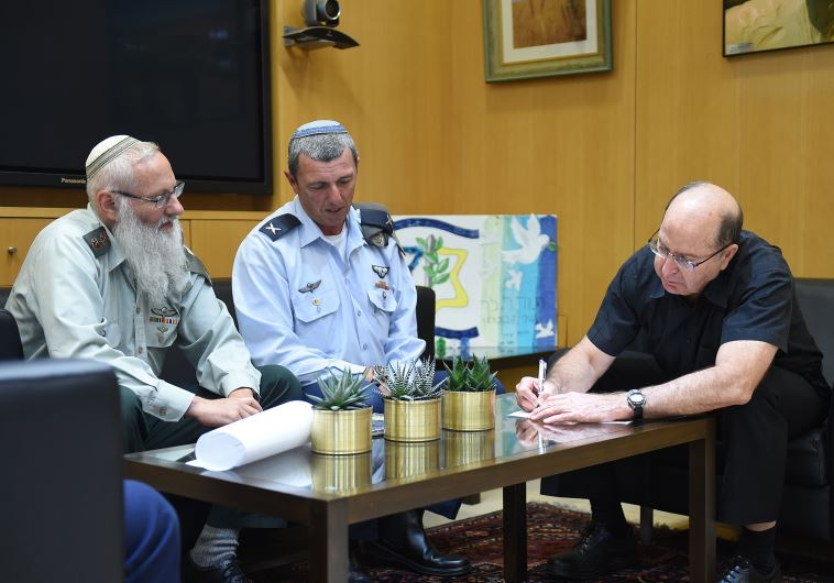 Rabbi Col. Eyal Karim (left), nominated to become IDF chief rabbi, sits next to his predecessor, Bri