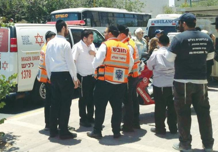 AMBULANCE STAFF in Ashdod attend the scene on May 30 where an infant left in a car died.