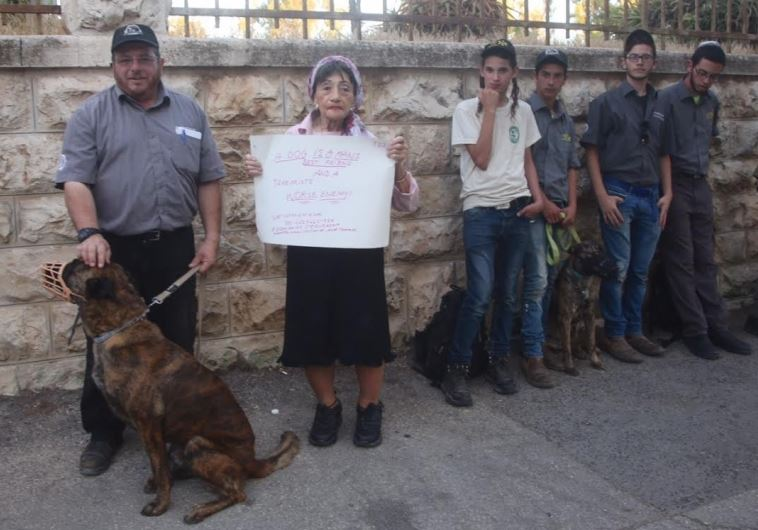Mike Ben Yaakov, commander of the Israeli Dog Unit (left) stands next to Shifra Hoffman, founder of