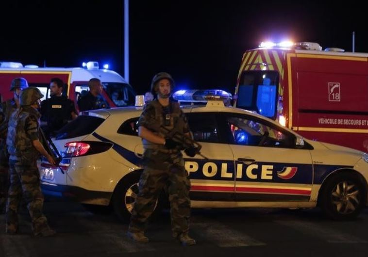 French soldiers and rescue forces are seen at the scene whare at least 30 people were killed in Nice