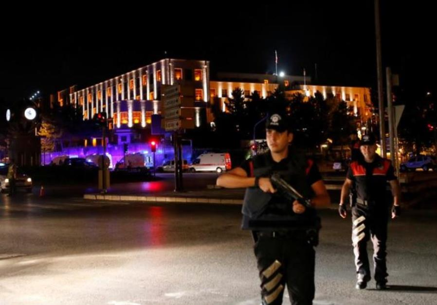 Police officers stand guard near the Turkish military headquarters in Ankara, Turke