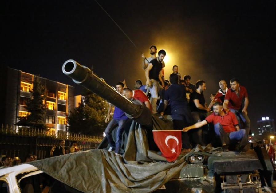 People stand on a Turkish army tank in Ankara, Turkey July 16, 2016