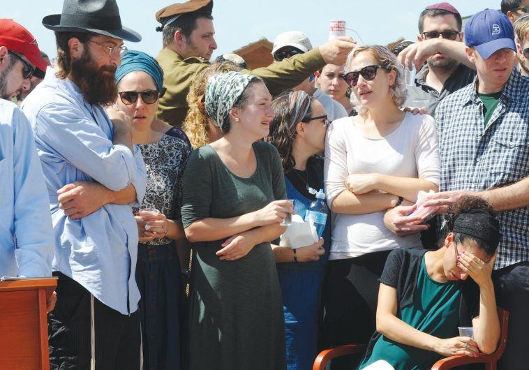 SGT. SHLOMO Rindenow's family members mourn at his funeral yesterday at Netzer Hazani.