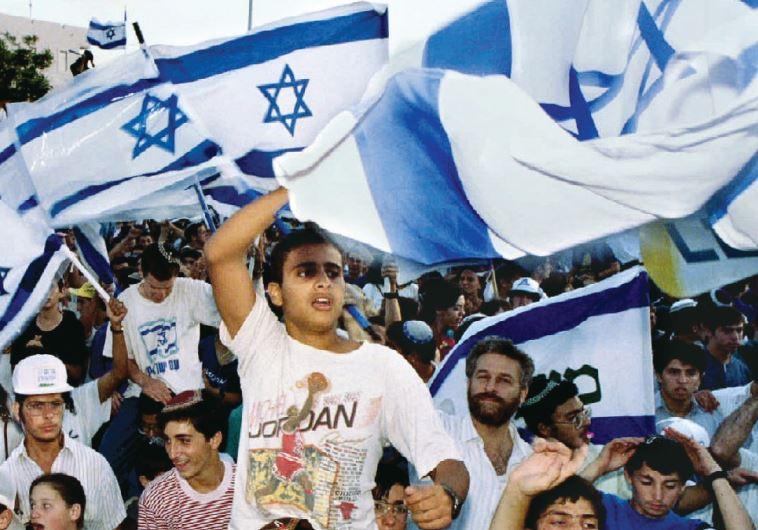 Israelis wave flags