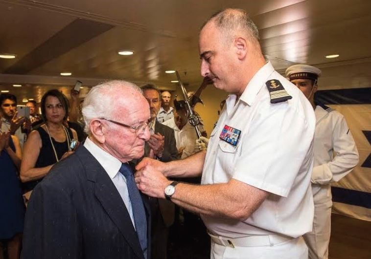 DR. RENE KARAT receives the French Legion of Honor from Captain Laurent Sudrat in Haifa.