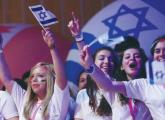 Birthright participants wave flags and cheer during a recent event in Jerusalem.