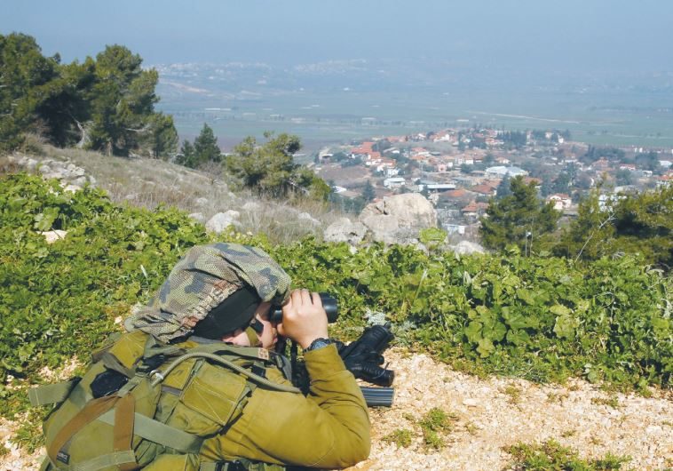 A SOLDIER near Metulla monitors Lebanon