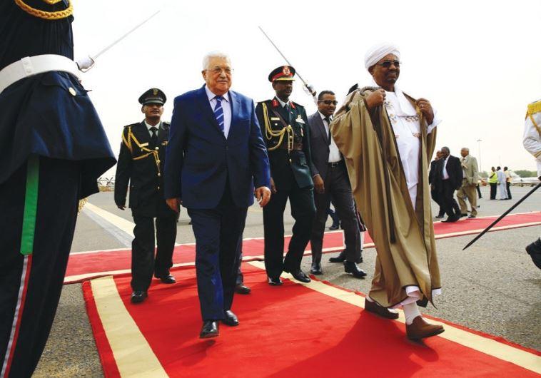 SUDANESE PRESIDENT Omer Hassan al-Bashir welcomes PA President Mahmoud Abbas at Khartoum Airport on