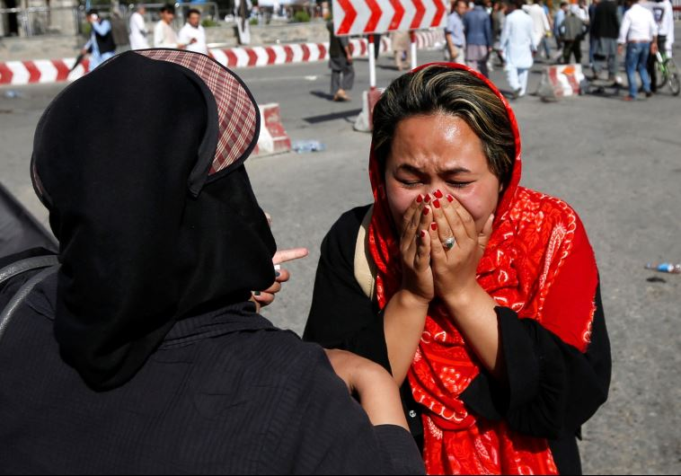 An Afghan woman weeps at the site of a suicide attack in Kabul, Afghanistan July 23, 2016