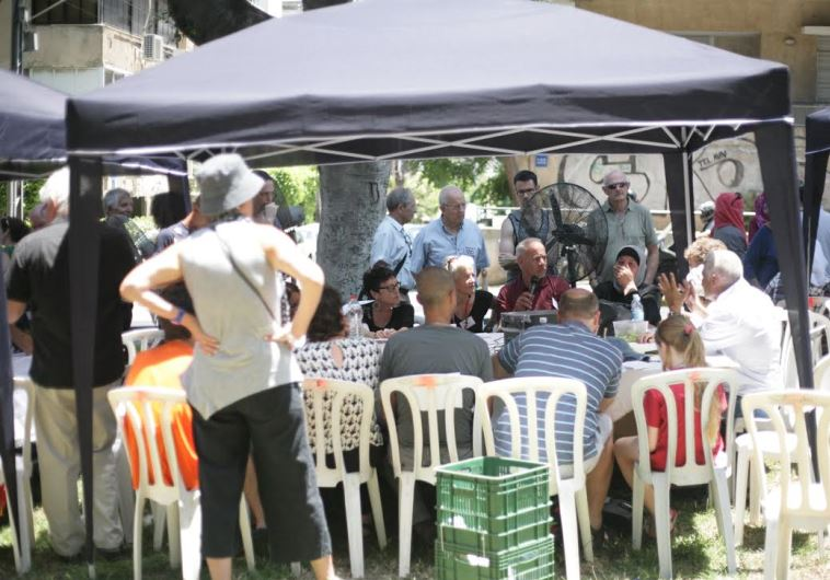 SOME OF THE 500 Israelis and Palestinians who met in Tel Aviv on Friday for a 'public negotiating co