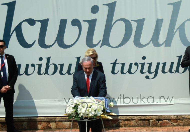 PRIME MINISTER Benjamin Netanyahu lays a wreath as Rwandan President Paul Kagame and First Lady Jean