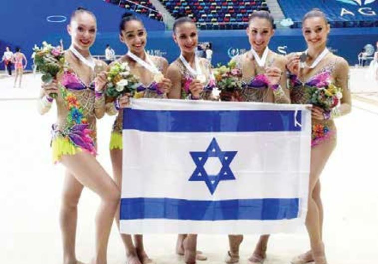 The members of Israel's rhythmic gymnastics national team pose with the gold medals they won yesterd