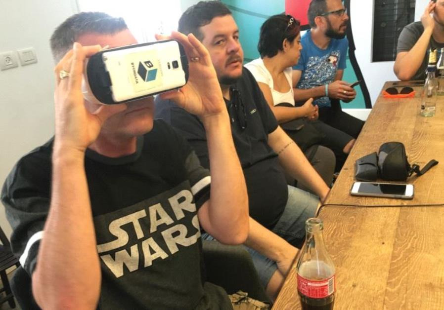 CONFERENCE GUESTS try out a ByonData virtual experience in Tel Aviv yesterday.