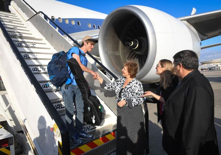 Ilan Eckhardt is welcomed at Ben-Gurion Airport on July 19 by Immigration and Absorption Minister So