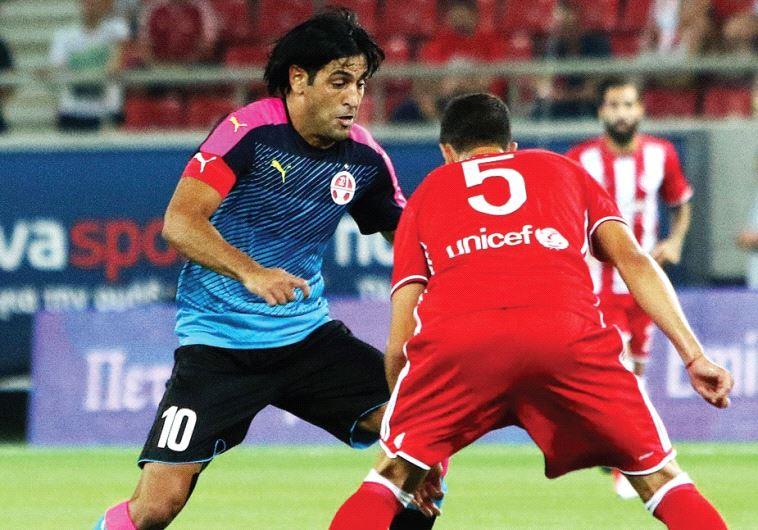 Hapoel Beersheba captain Elyaniv Barda (left) may not have scored last night, but was still delighte
