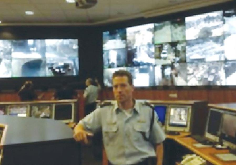 POLICE SPOKESMAN Micky Rosenfeld stands inside the state-ofthe- art police headquarters, Mabat 2000,