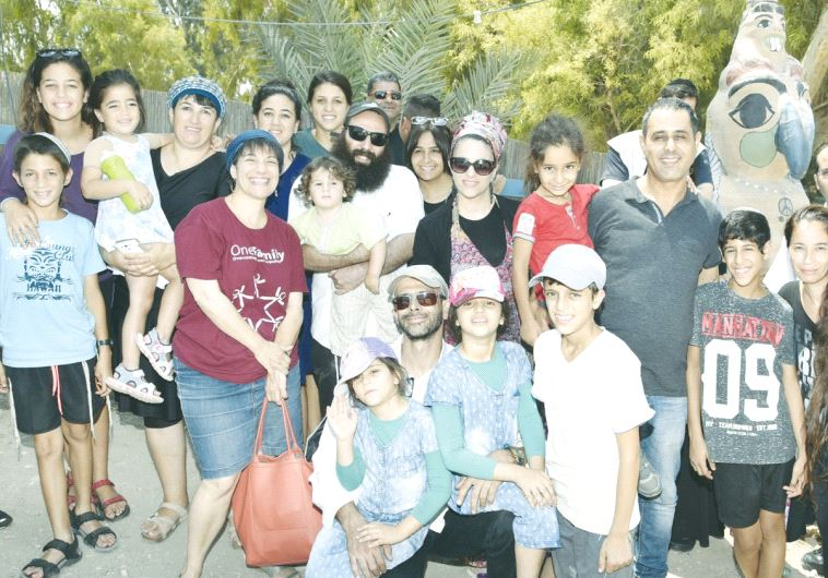 A GROUP OF terrorism victims and their families pose for a photo at a three-day retreat this week
