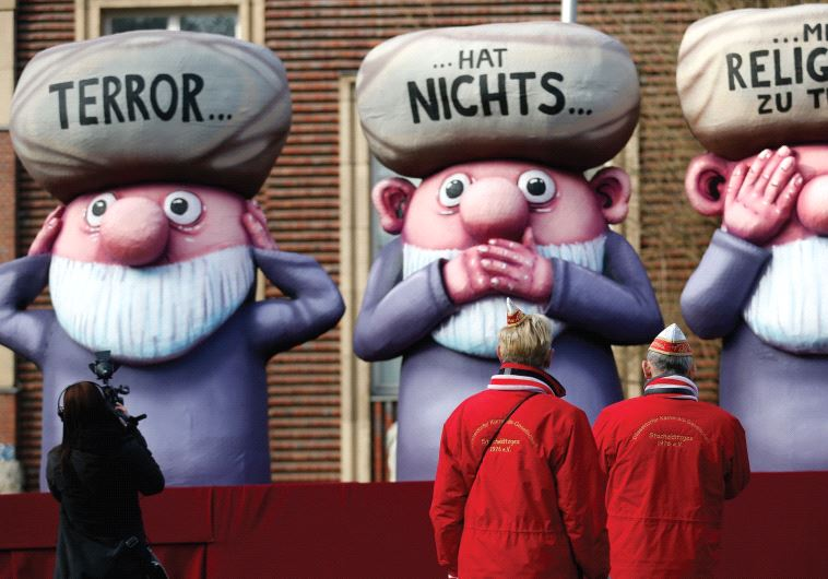 THIS FLOAT at a German parade has the words 'Terror has nothing to do with religion' written on thre